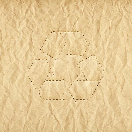 Old paper background with recycle symbol photo