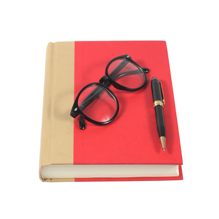 Red book with glasses and pen isolated on white background photo