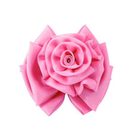 factitious: pink fabric flower isolated on a white background.