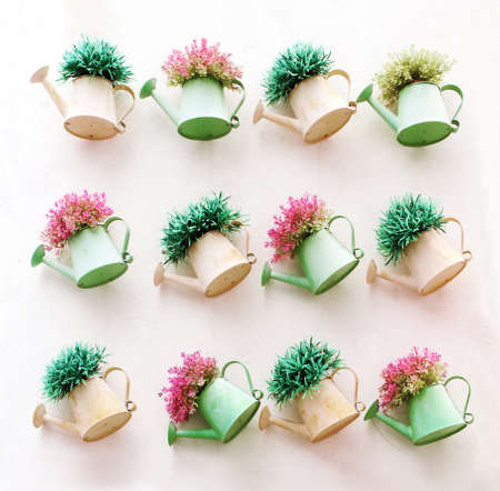 Artificial colorful flowers pots hang onto the wall photo