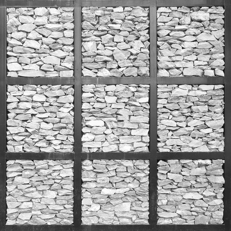 stone wall in the metal frame background photo