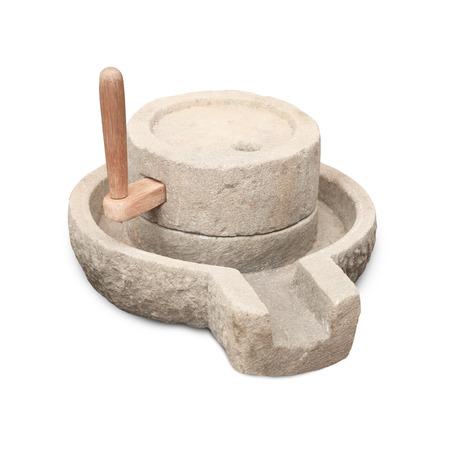 Old manual stone millstones on a white background Archivio Fotografico