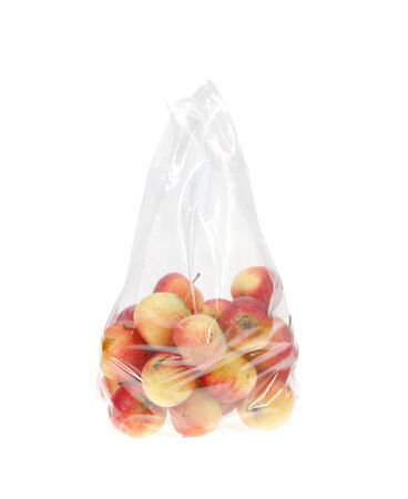 Apples in plastic bag isolated on white. Stock Photo