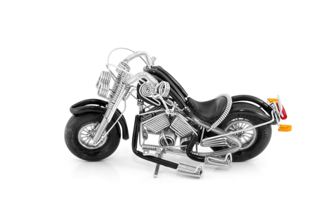 mini motorcycle made from wire , on white background photo