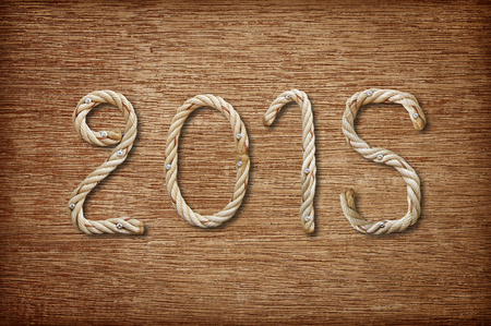 2015 made ​​of rope on wood background photo