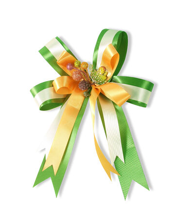 Decorative green and yellow color ribbon bow on white  photo