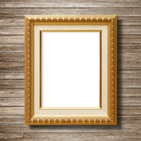 antique gold frame on wooden wall photo