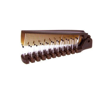 Pocket comb on isolated white  Stock Photo