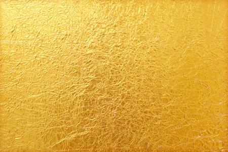 Glanzend geel blad goud folie textuur achtergrond