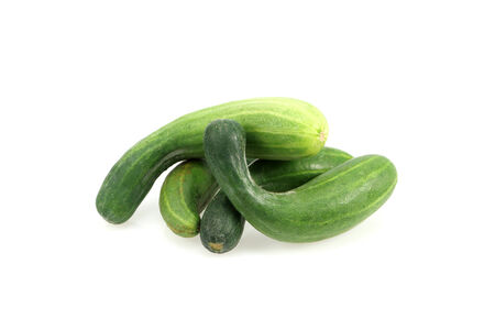 Imperfect cucumbers Isolated on a white background. photo