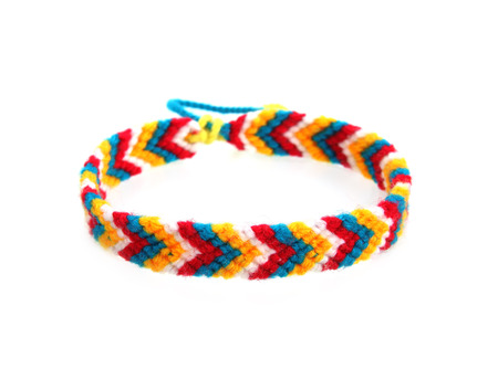 Knitted wristband on a white background