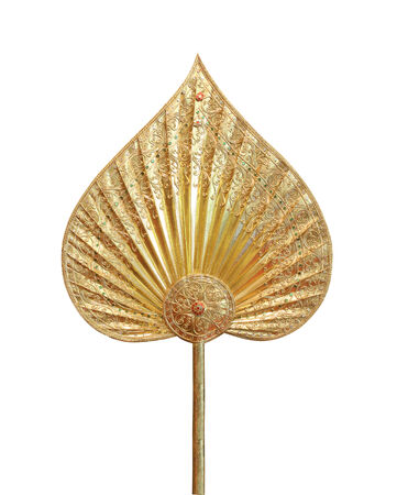 dhamma: golden talipot fan on white background Stock Photo