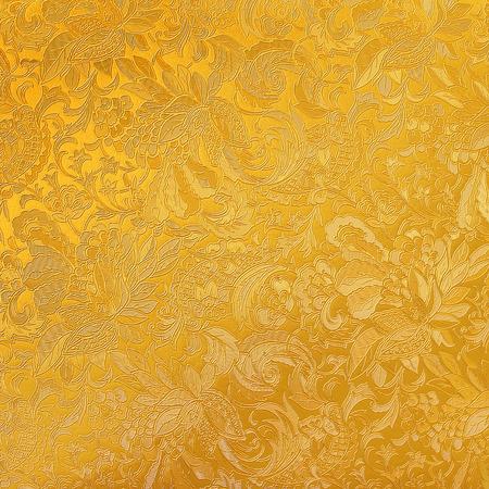 Golden floral ornament brocade textile pattern photo