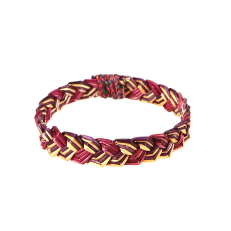 wristband: wristband made from woven straw on a white background.