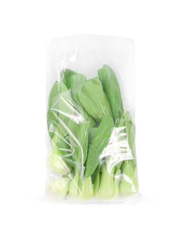 brassica: chinese cabbage in plastic bag  on a white background Stock Photo