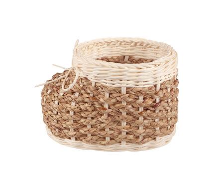 wicker basket  shaped like a shoe on white background photo