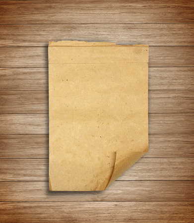 frowzy: Old scrap paper on wooden wall