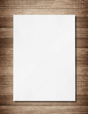 white paper on wood background and shadow photo