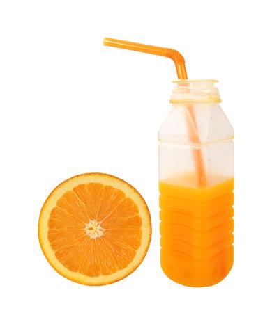 Orange juice in plastic half bottle Slice orange isolated on white