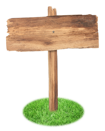 old wooden sign on the grass isolated on white background photo