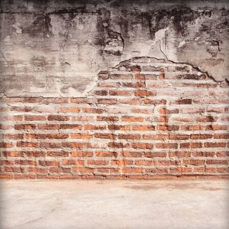 Moldy brick wall with floor background