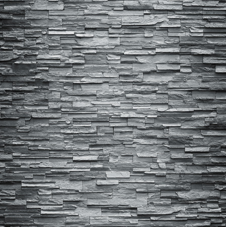 black stones: pattern of decorative slate stone wall surface