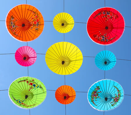 hanging up: umbrellas hanging up with blue sky background Stock Photo