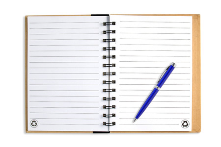 Note book with blue pen, isolated on white photo