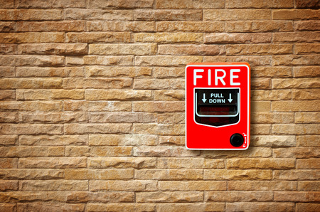 fire damage: fire break glass alarm switch on the wall