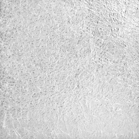 Shiny silver foil texture background Standard-Bild
