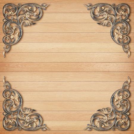 Pattern of wood frame carve flower on wood background photo