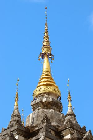 tiered: tiered golden umbrella
