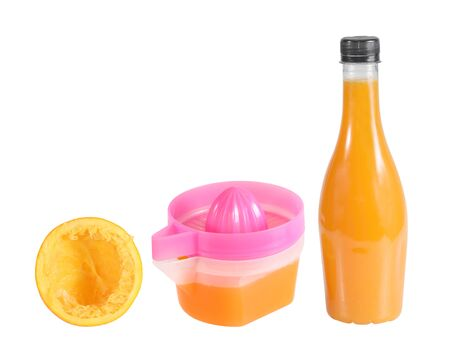 juicer with orange juice in the bottle isolated on white photo