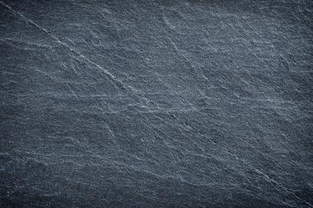 Donker grijs zwart leien achtergrond of textuur.