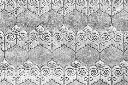 silver pattern Crafts wall in the temple of thailand Lanna style Chiang Mai, Thailand. photo