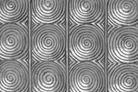 metal pattern Crafts spiral coil wall in the temple of thailand Lanna style Chiang Mai, Thailand. photo