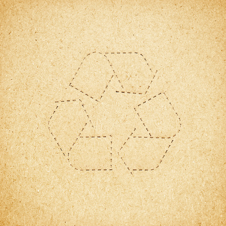 Rough paper texture with recycle symbol photo