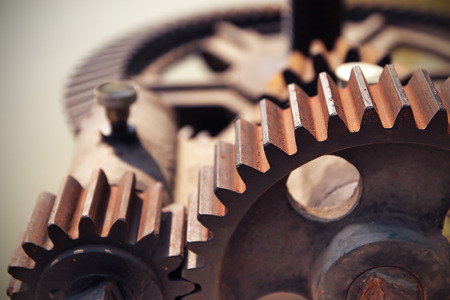 close together: close-up mechanical gear with a large toothed wheel of Floodgate valve with color Effect