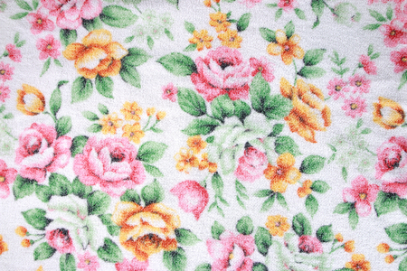 Flower pattern on the towel background. photo