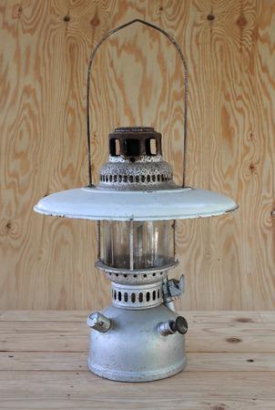 hurricane lamp: hurricane lamp on wood background