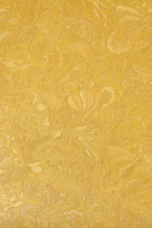 Golden floral ornament brocade textile pattern