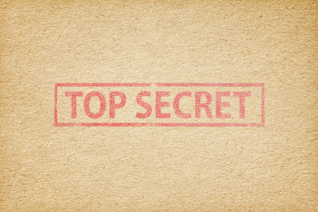 top secret: Top secret stamp on the brown paper background