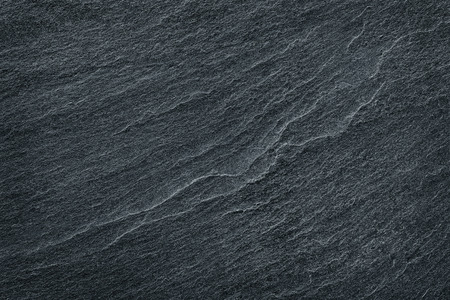 black granite: black slate stone background or texture