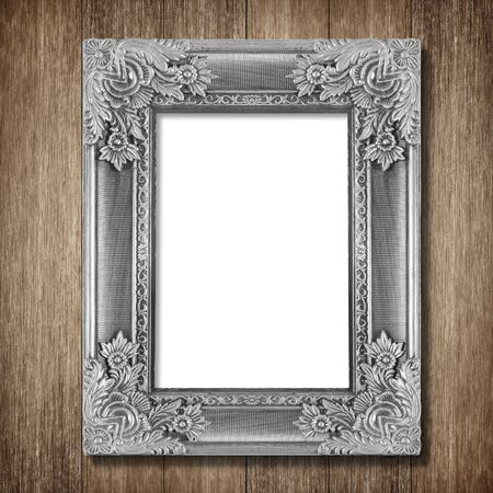 silver picture frame: Antique frame on wooden wall background