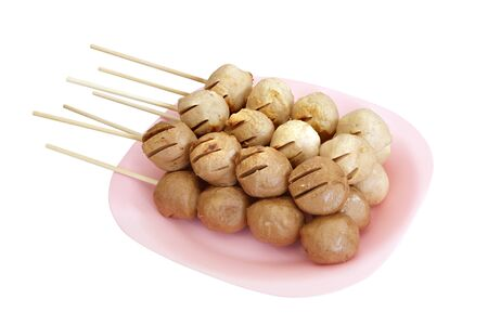meat grill: Meatball skewers grill on plate isolated on white