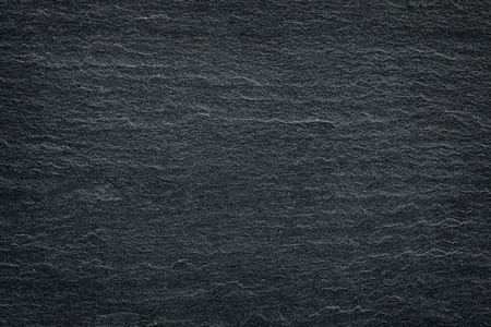 distressed texture: Dark grey black slate background or texture.