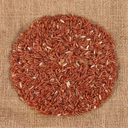 sack cloth: red rice on sack cloth top view Stock Photo