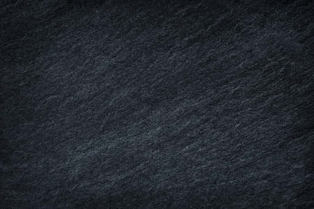grey texture: Dark grey black slate background or texture.