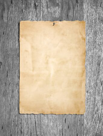 blank poster: Old grunge paper on gray wood or wooden wall background Stock Photo