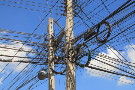 cable tangle: Messy cable connection on the electric pole Stock Photo